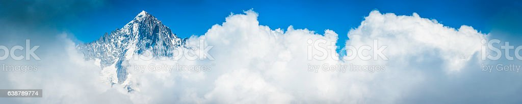Alps mountain peak soaring above the clouds panorama Grandes Jorasses stock photo