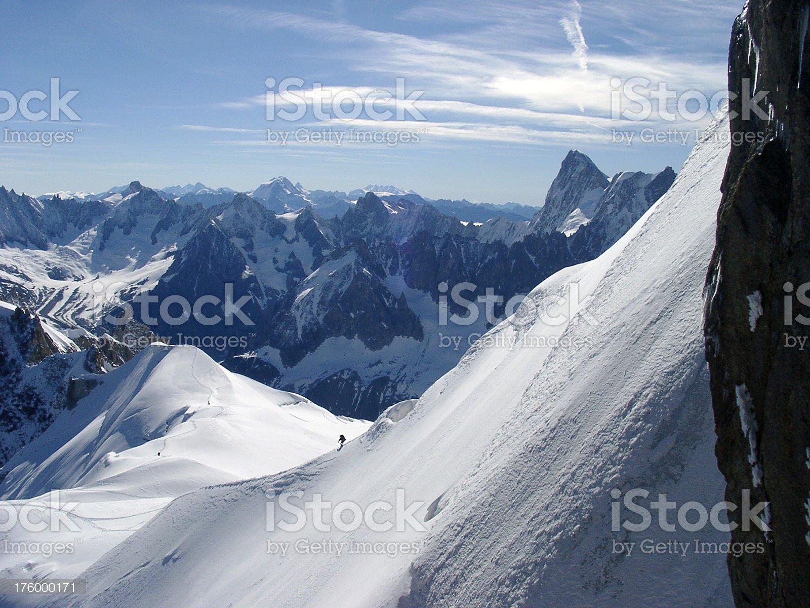Alps mountain peaks man walking along ridge royalty-free stock photo