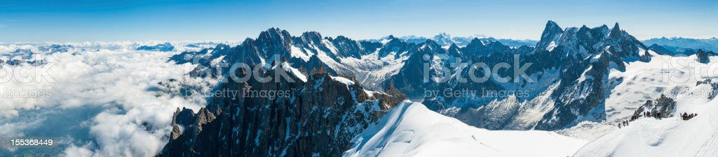 Alps mountaineers on Aiguille du Midi Mont Blanc Chamonix France royalty-free stock photo