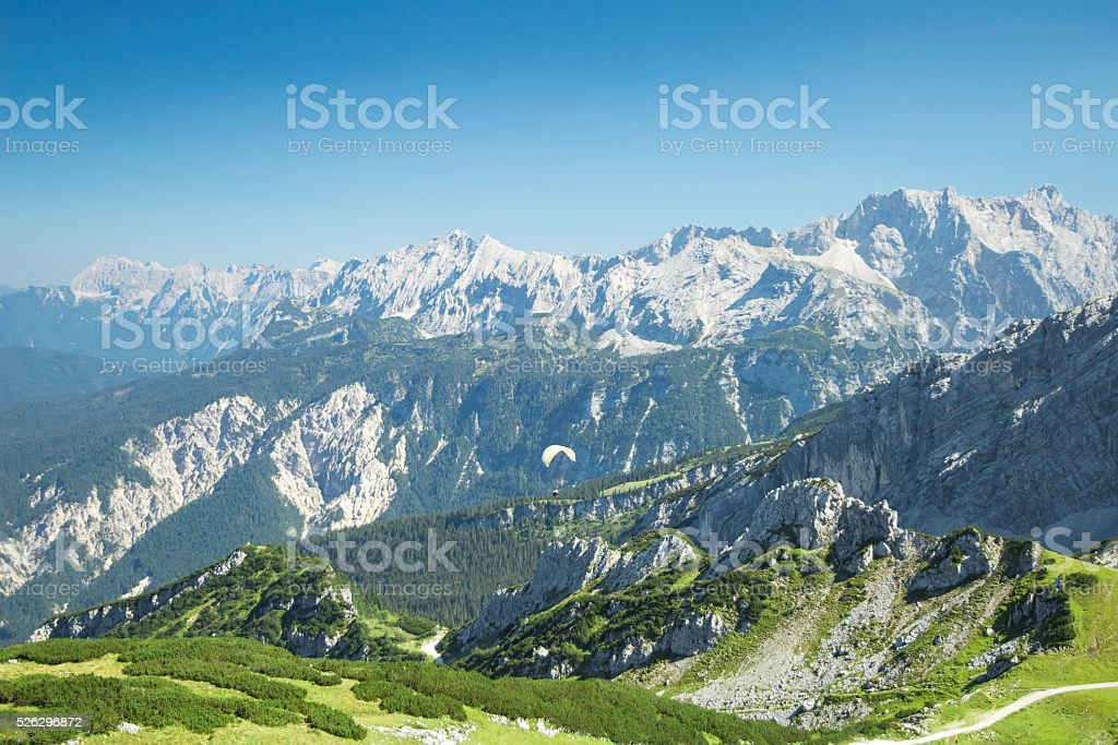 Alps mountains aerial view with paraglider over Alpine landscape stock photo