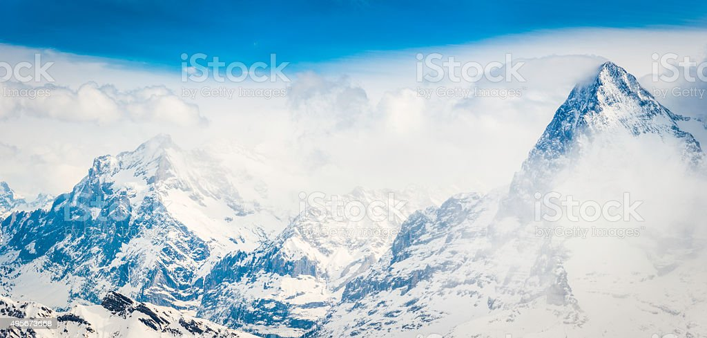 Alps North Face of Eiger overlooking mountain peaks panorama Switzerland stock photo