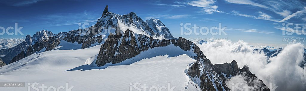 Alps rocky pinnacles crisp white snow mountain peaks above clouds stock photo