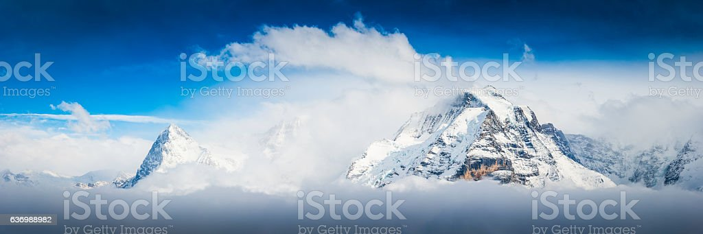 Alps snow capped summits of Eiger and Jungfrau panorama Switzerland stock photo