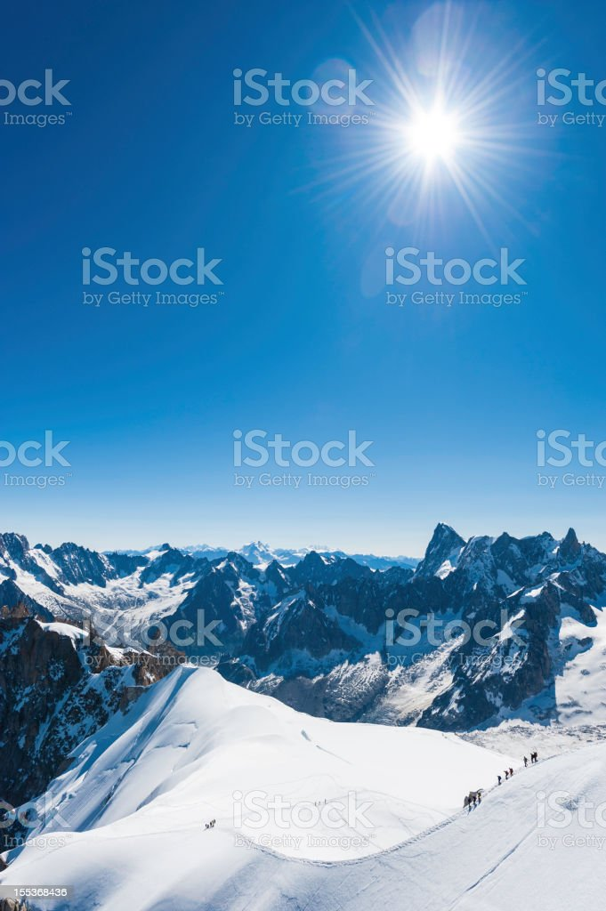 Alps snow summit sunburst mountaineers Mont Blanc France royalty-free stock photo