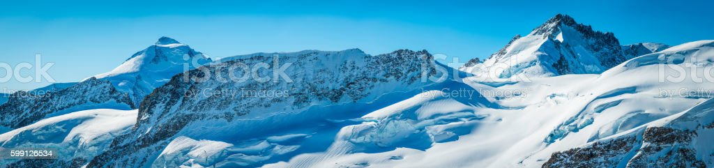 Alps snowy alpine mountain peaks panorama glaciers crevasses Jungfrau Switzerland stock photo