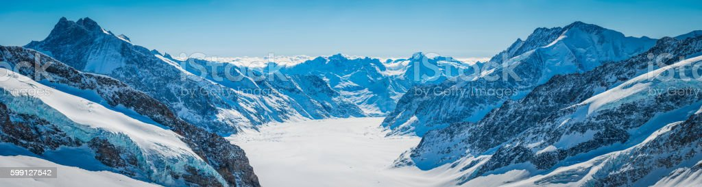 Alps snowy mountain peaks panorama overlooking Aletsch glacier Valais Switzerland stock photo