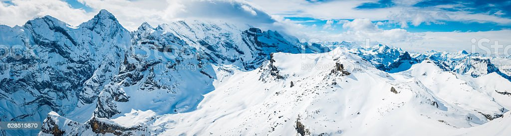 Alps snowy peaks off piste ski runs winter panorama Switzerland stock photo