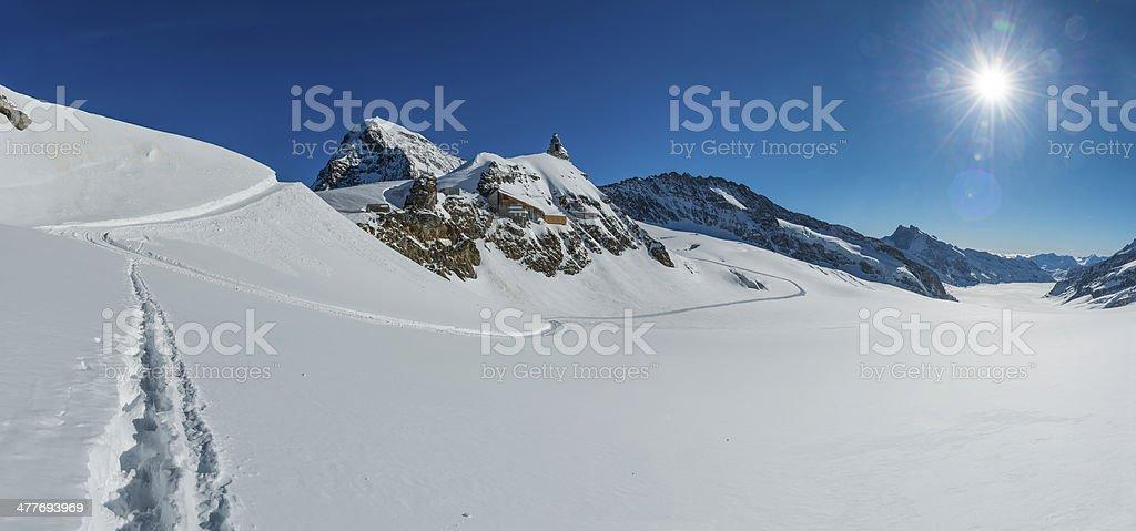Alps sunburst over winter mountain peaks Sphinx Obsevatory Junfraujoch Switzerland stock photo