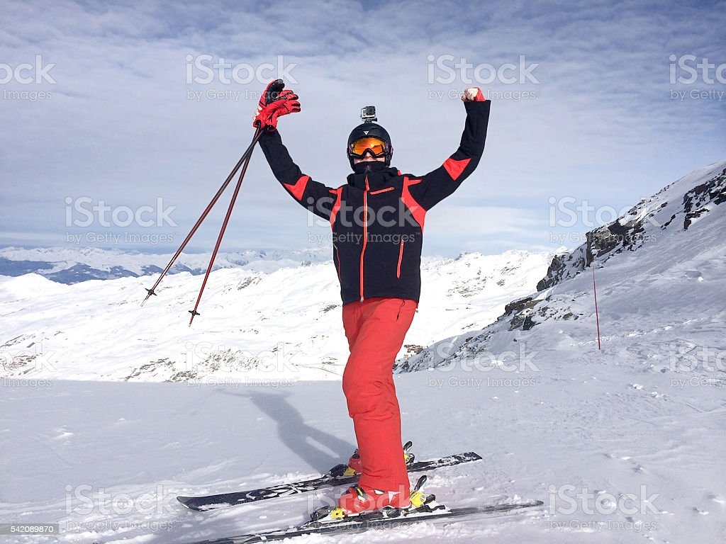 Alps. The mountain skier  be in raptures at mountain top. stock photo