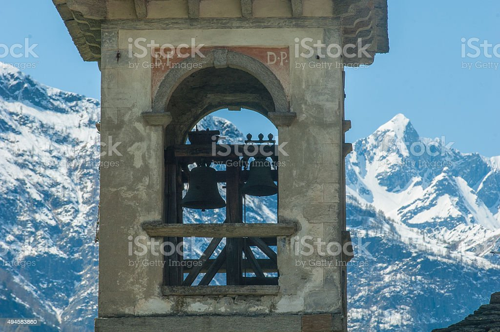 Alps view through a bell tower royalty-free stock photo