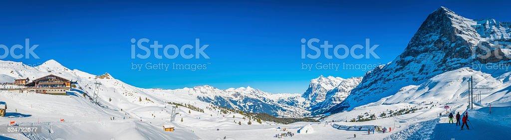 Alps winter sports ski resort skiers snowy mountains panorama Switzerland stock photo