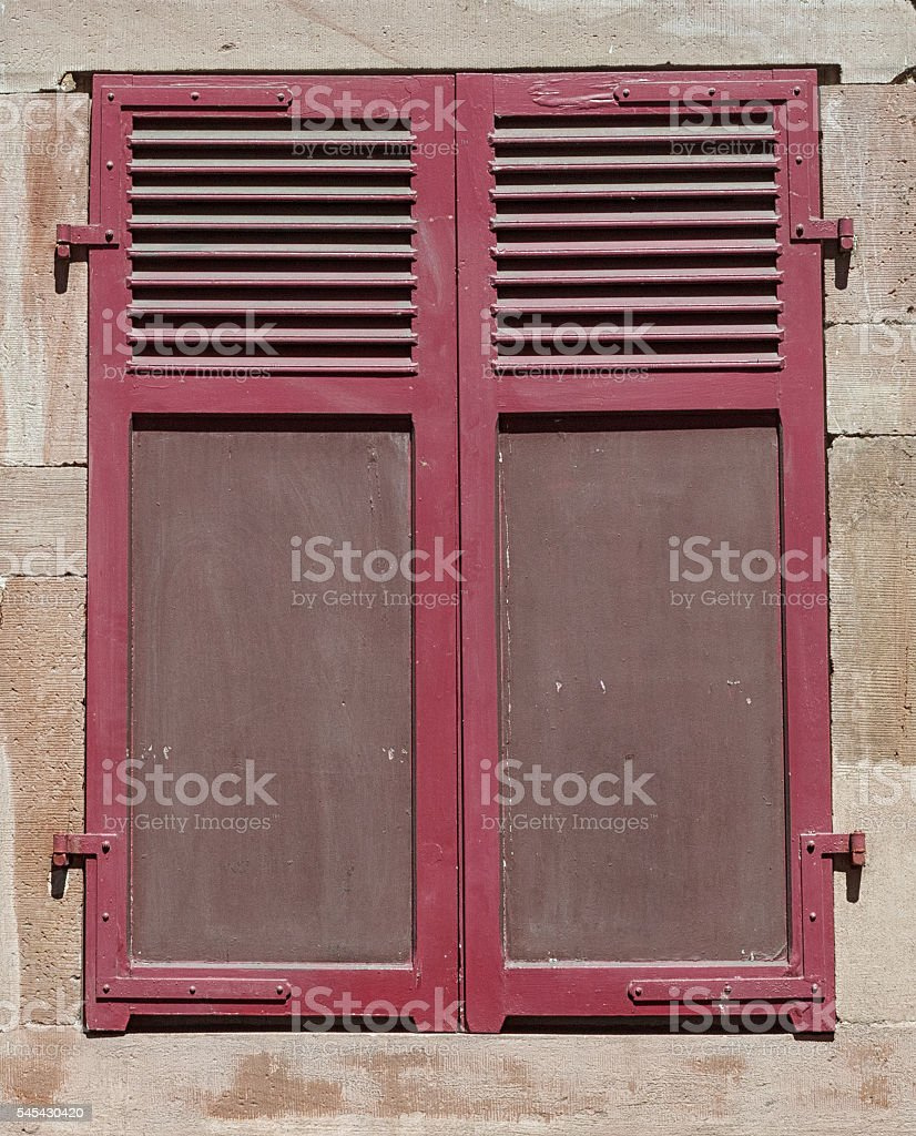 Alsace: Red wooden shutter in the old town of Strasbourg stock photo