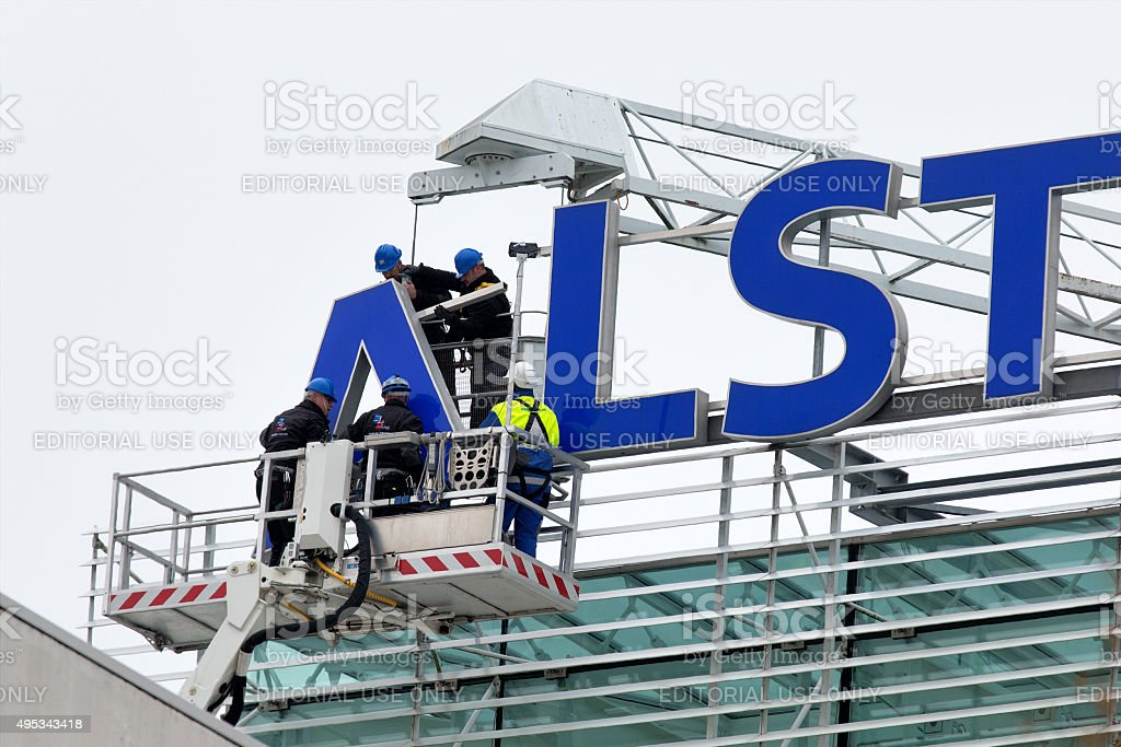 Alstom logo being removed from rooftop stock photo
