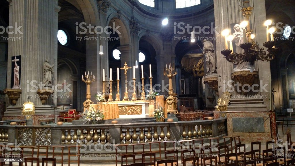 altar and candles Mass at St Sulpice Cathedral Paris France stock photo