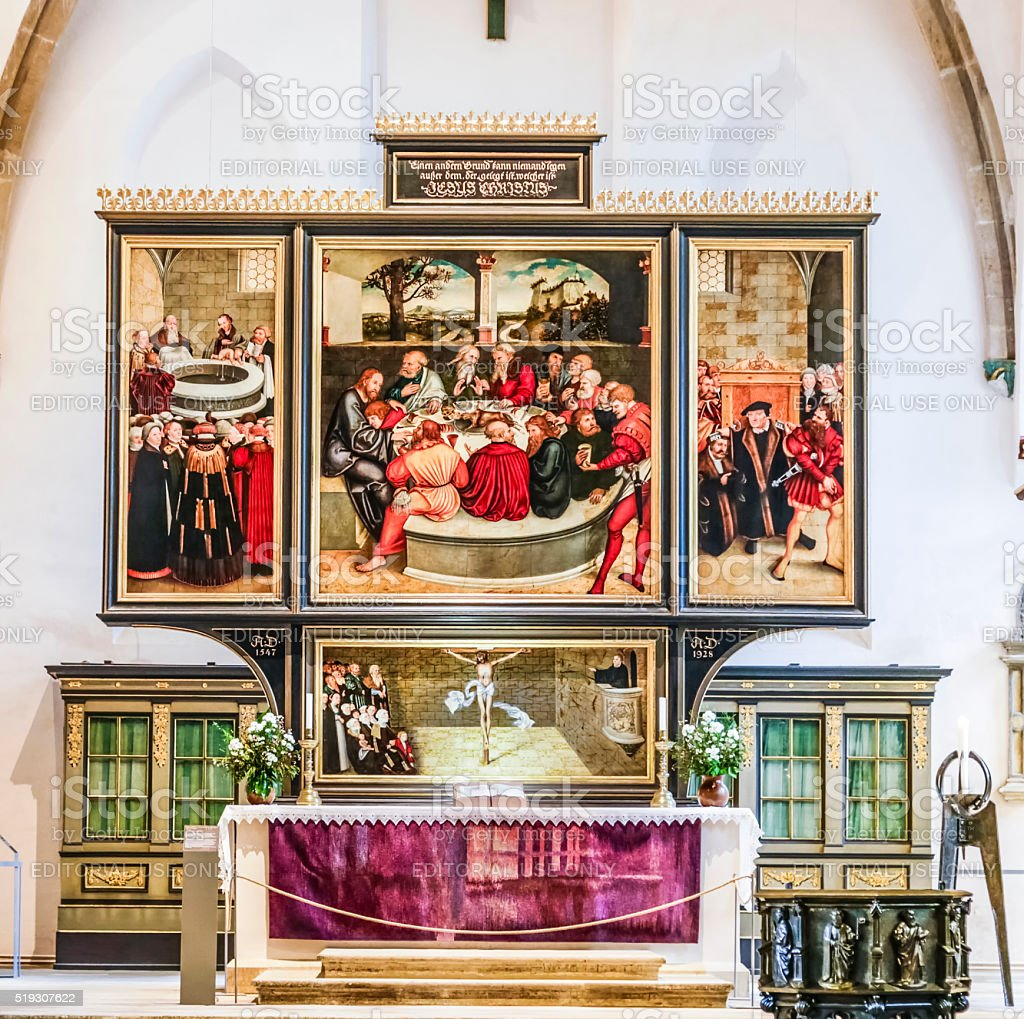 altar from Lucas Cranach in the civic church in Wittenberg stock photo