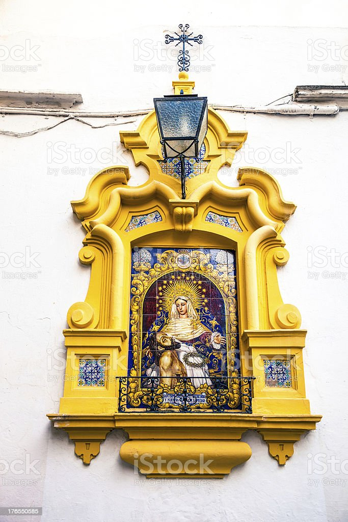 Altar in an old alley; Seville, Spain royalty-free stock photo