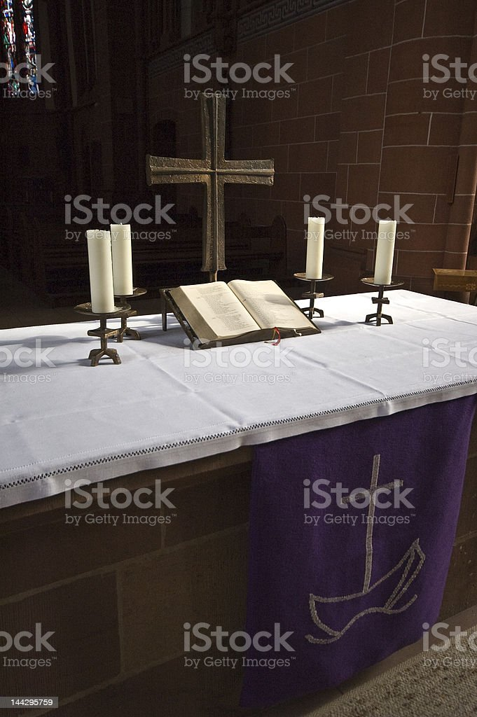 Altar with Bible, cross and four candles royalty-free stock photo