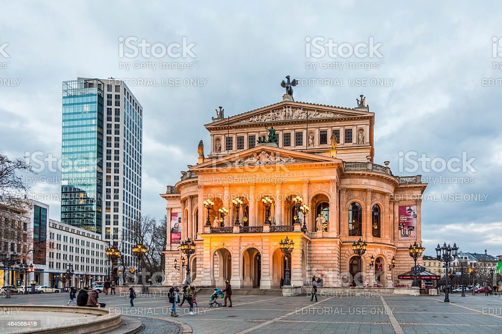 Alte Oper in Frankfurt. Night view with people stock photo