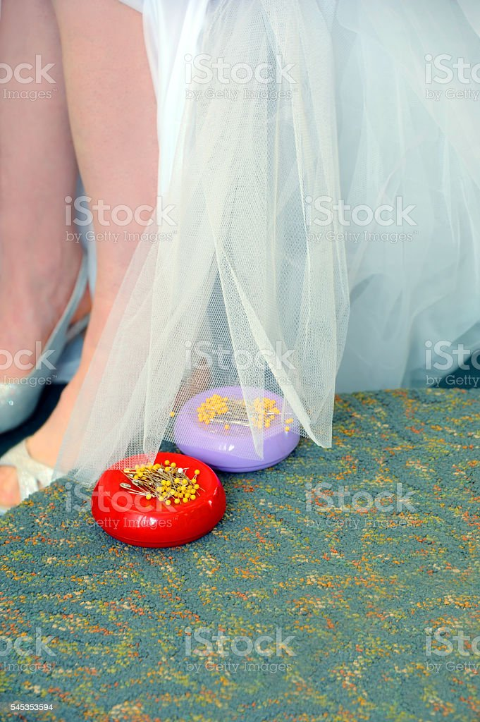 Alteration to Bridal Gown stock photo
