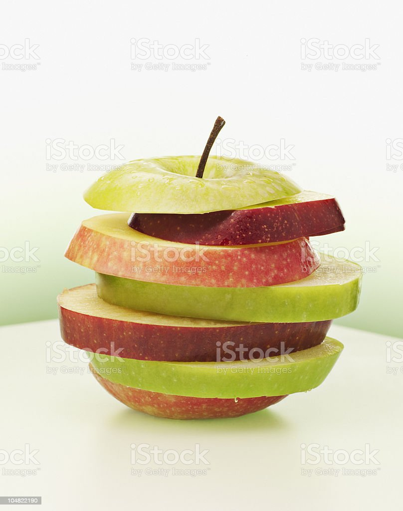 Alternating red and green apple slices stock photo