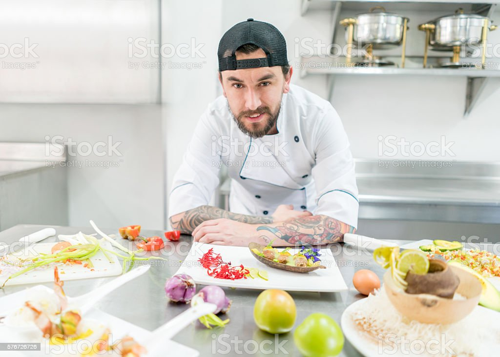 Alternative chef presenting appetizers stock photo