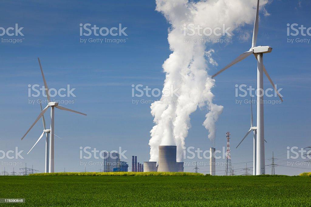 Alternative energy  against power plant stock photo