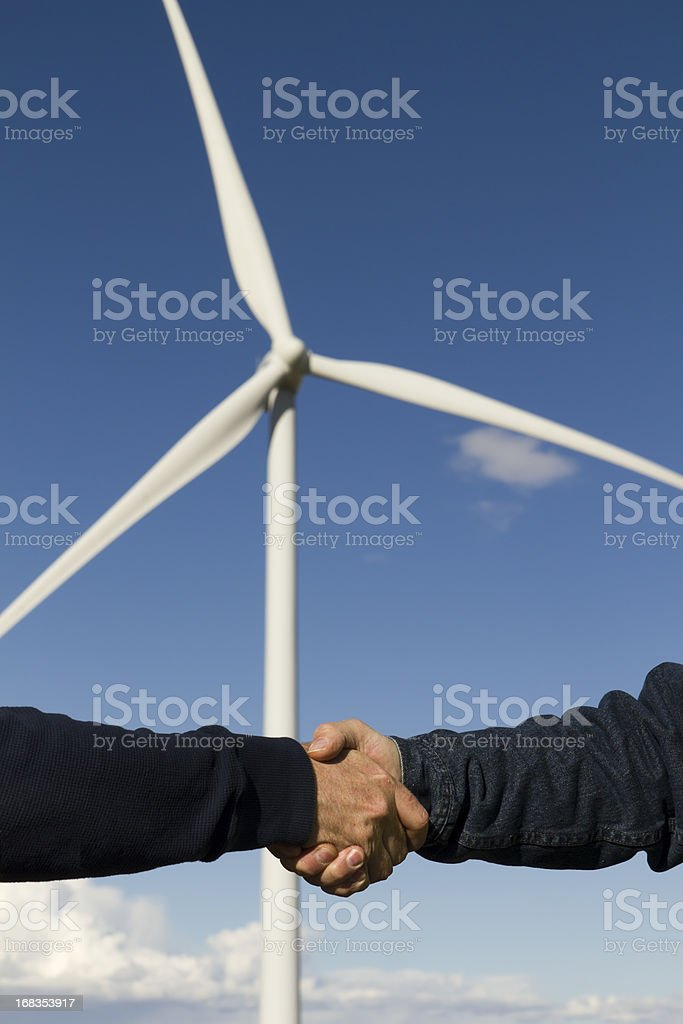 Alternative Energy Handshake royalty-free stock photo