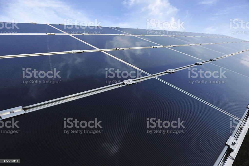 Alternative energy photovoltaic solar panels against blue sky royalty-free stock photo