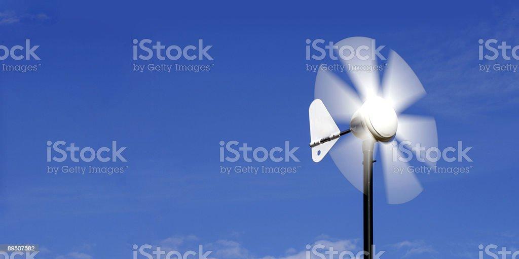 alternative energy wind vane stock photo