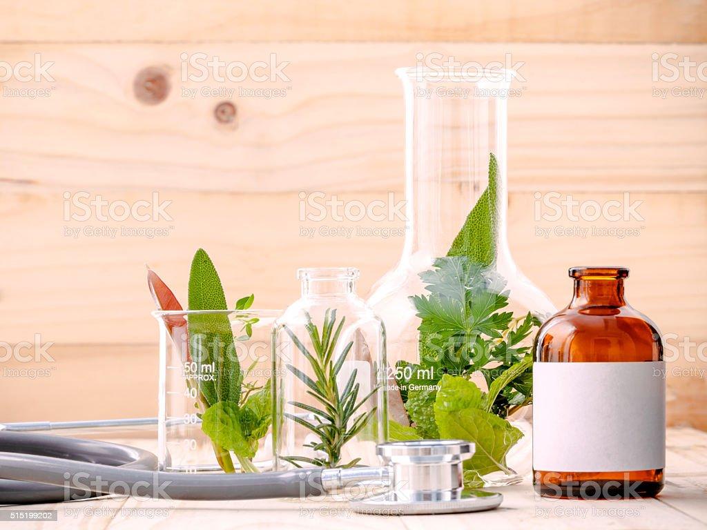 Alternative health care fresh herbal in laboratory glassware . stock photo