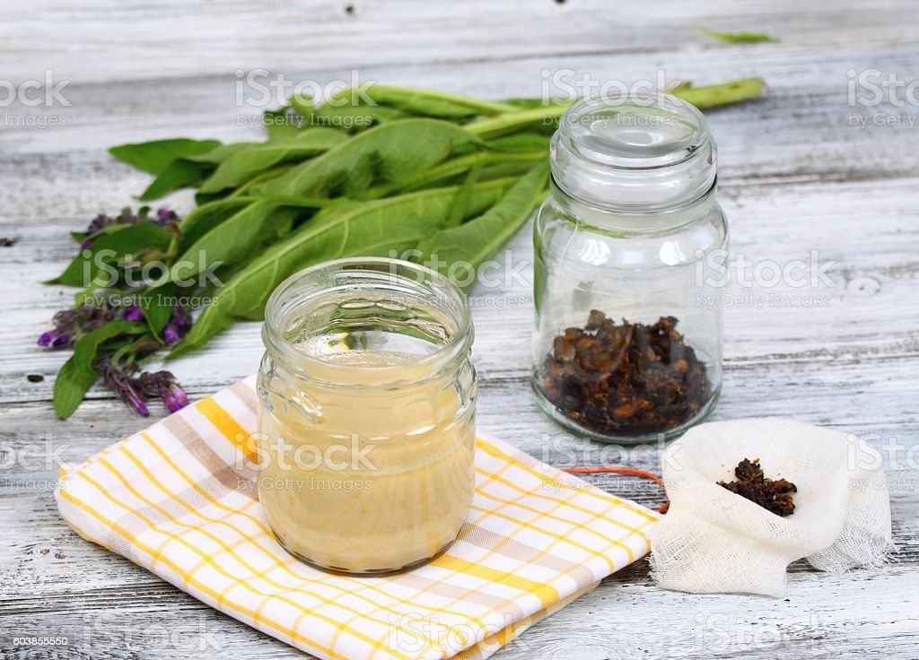 Alternative medicine,  filtering Comfrey ointment good for bones stock photo