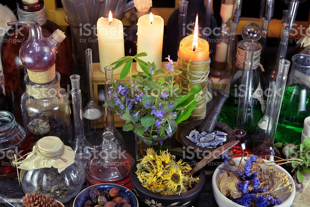 Alternative medicine still life with bottles, berries and herbs stock photo