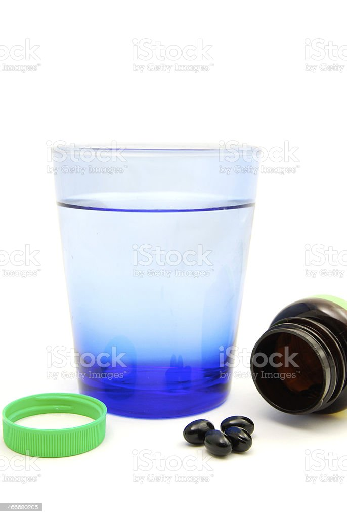 Alternative Medicine Vitamin Pill Bottle with Water stock photo