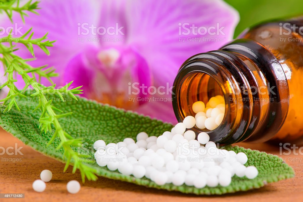 alternative medicine with herbal pills stock photo