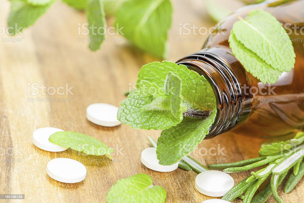 Alternative medicine with homeopathic pills and herbal royalty-free stock photo