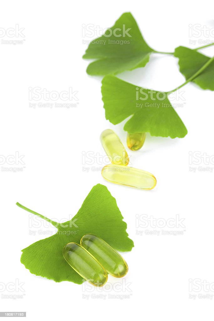 Alternative medicine:ginkgo leaf and pill isolated on white stock photo