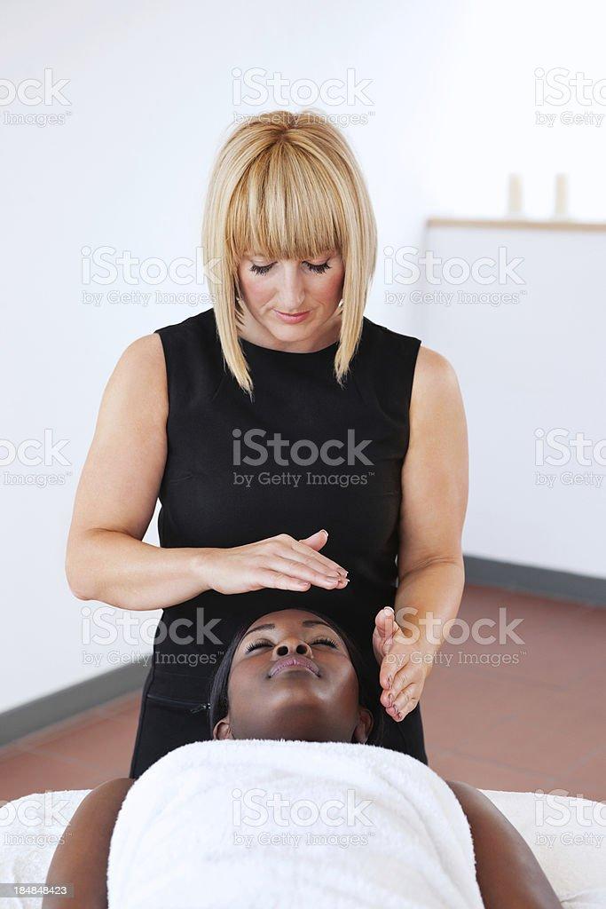 Alternative Therapist Giving Reiki Treatment stock photo