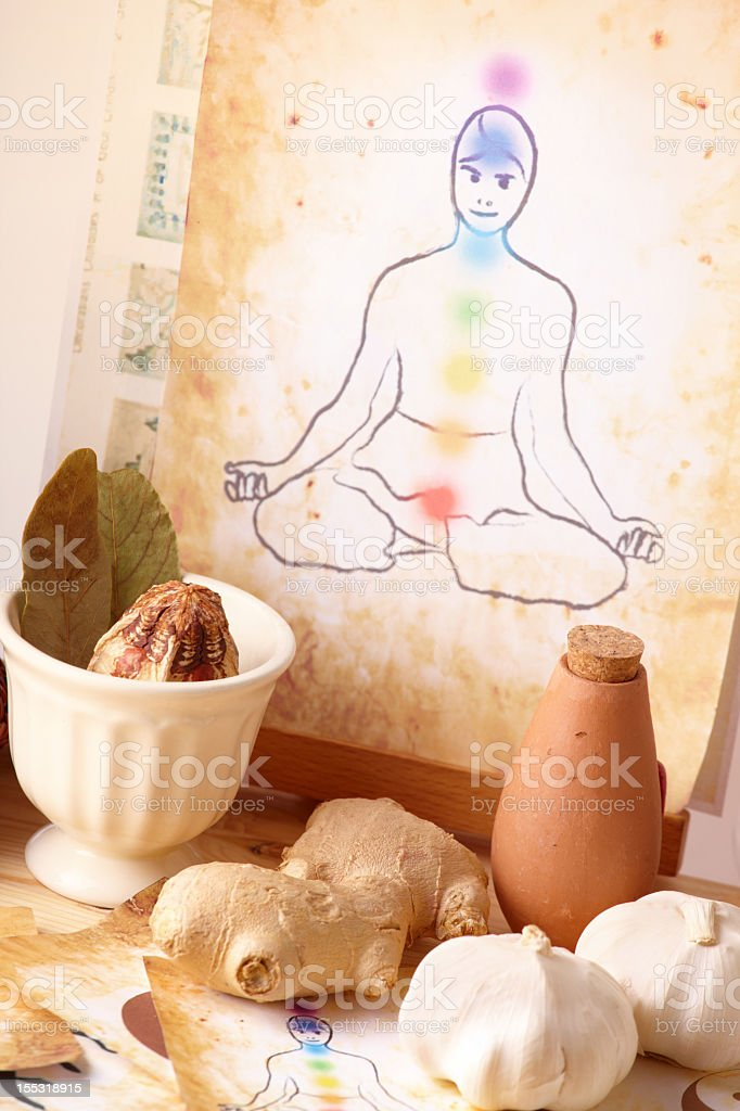 Alternative therapy items plus drawing of figure meditating royalty-free stock photo
