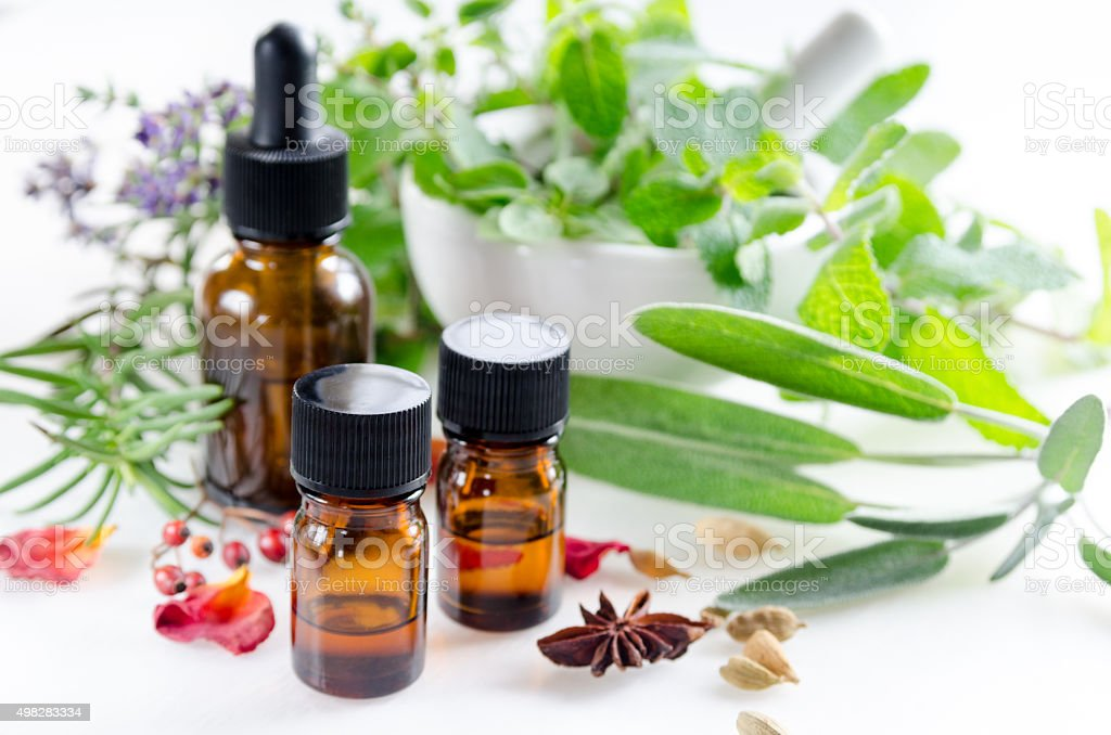 alternative therapy with herbs and essential oils stock photo