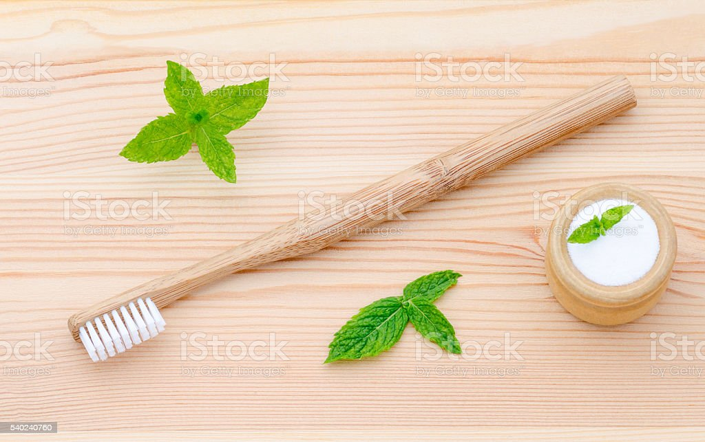 alternative wood toothbrush and xylitol, soda, powder, salt, mint on stock photo