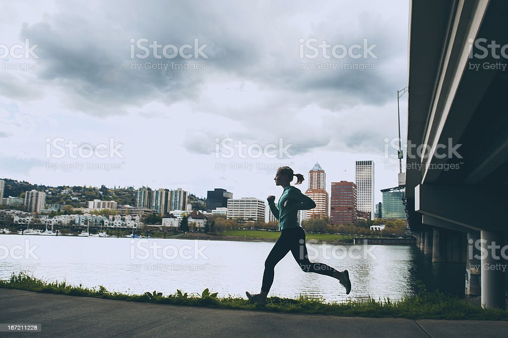 Althletic Woman Running in the City Healthy Lifestyle stock photo