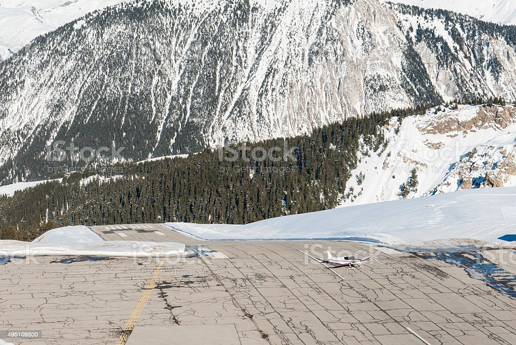 Altiport airport in an alpine mountain stock photo