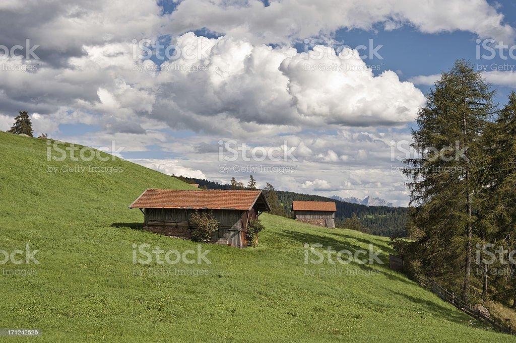 Alto Adige Italy Landscape Grazing Land Haystack Dolomites in Background stock photo