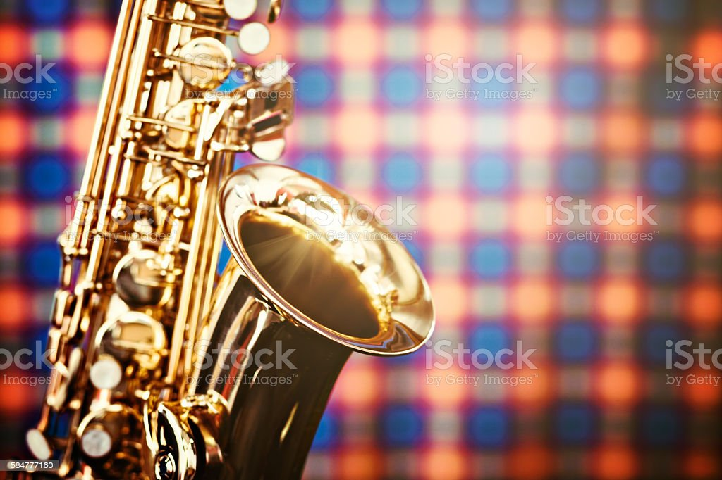 Alto sax in high-key, close-up detail on plaid background stock photo