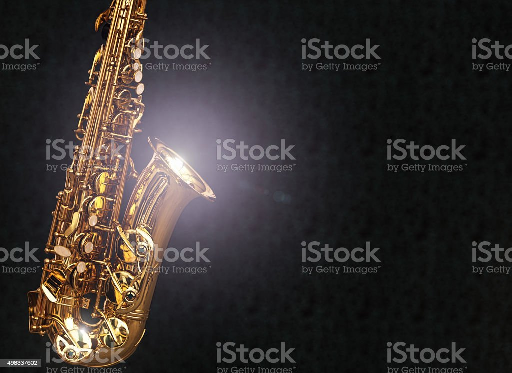 Alto saxophone shines on black background with copy space stock photo