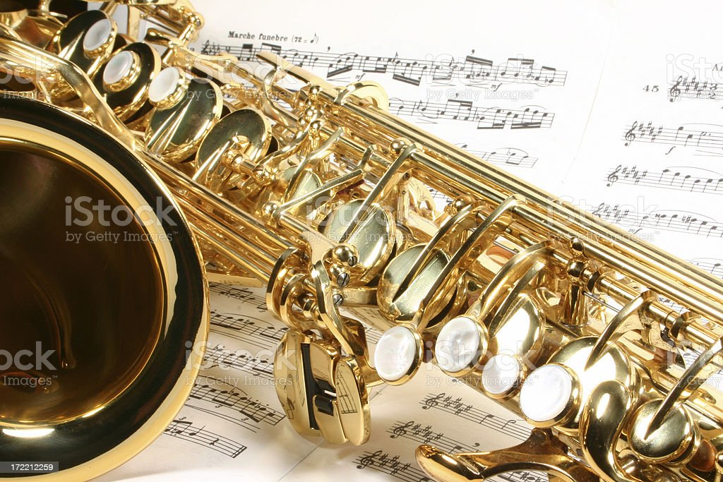 alto saxophone with sheet music stock photo