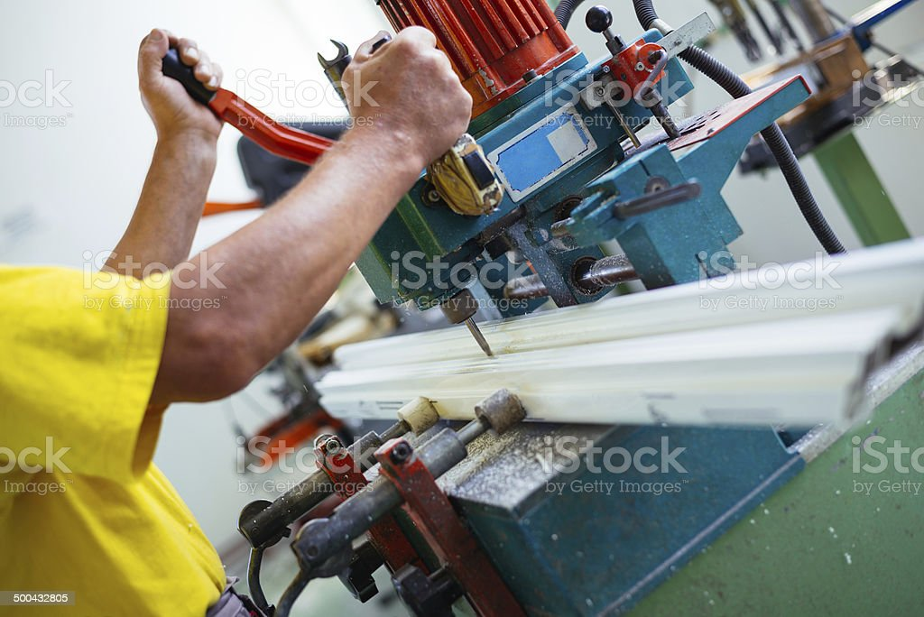 Aluminium and PVC windows industry worker royalty-free stock photo