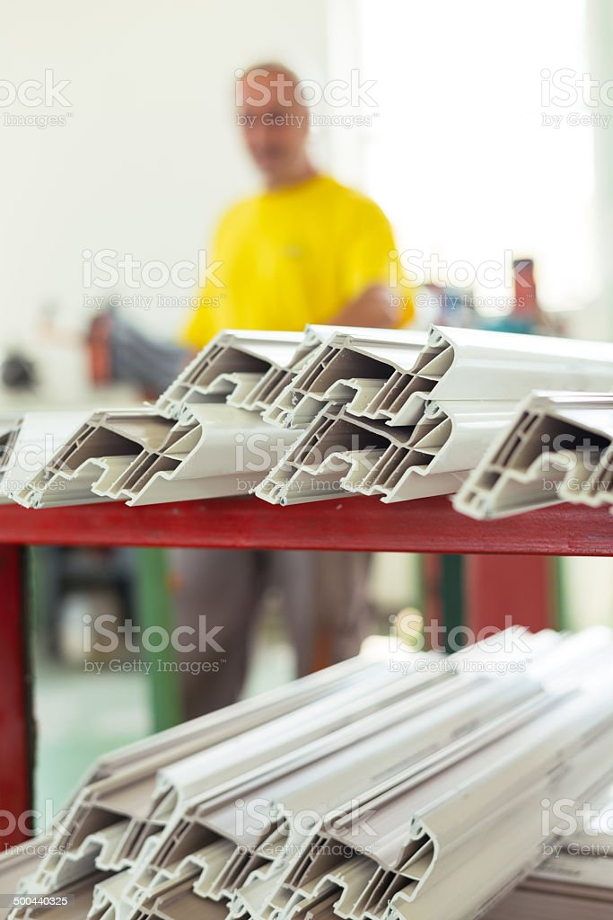 Aluminium and PVC windows industry worker royalty-free stock photo