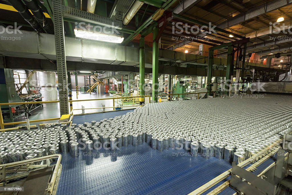 Aluminium cans being made in an industrial factory stock photo