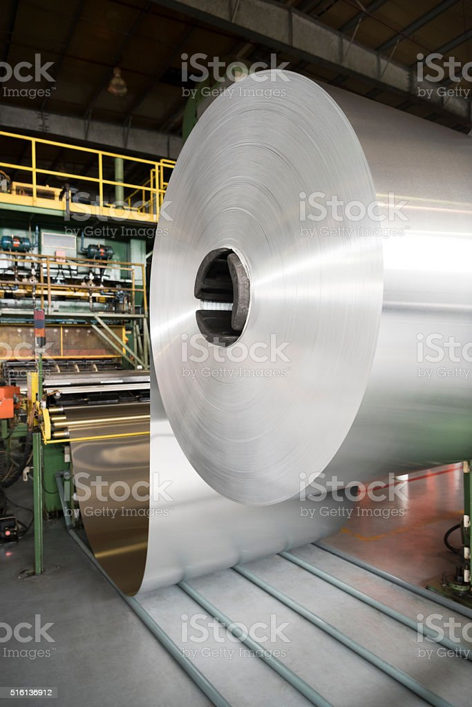 Aluminium rolled up on indutrial spool in factory stock photo